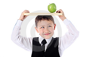 Schoolboy With Book And Apple Stock Images - Image: 10232274