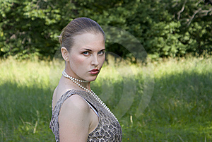 Beautiful Girl On A Green Wood Background Royalty Free Stock Photography - Image: 10232827