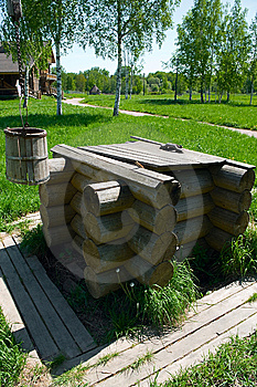 Wooden Draw Well With Bucket Royalty Free Stock Images - Image: 10245349