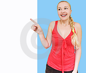 Smiling Woman Pointing Towards Copyspace Royalty Free Stock Images - Image: 10256359