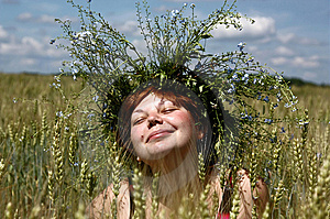 The Smiling Girl In A Garland Royalty Free Stock Photos - Image: 10257458