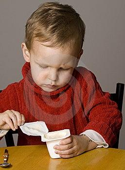 Boy Eating Yogurt Stock Images - Image: 10265174