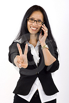Attractive businesswoman on the phone victory sign Stock Photos