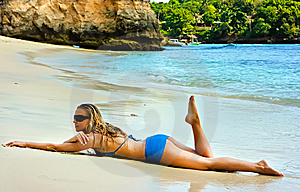 Blonde Lady Lying In Water On The Beach Stock Photography - Image: 10288412