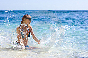 Girl Making Splashes In The Sea Royalty Free Stock Images - Image: 10288449