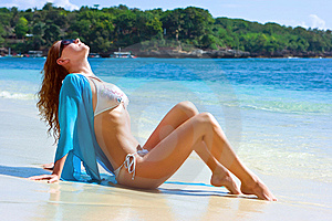 Brunette Girl Relaxing On The Beach Royalty Free Stock Photos - Image: 10288458
