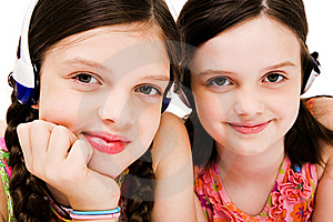 Smiling Girls Listening Music On Headphones Royalty Free Stock Photos - Image: 10293938