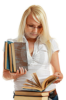 Young Girl Leaned Over Pile Of Books Royalty Free Stock Photo - Image: 10297895