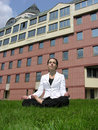 Stock Image - Yoga businesswoman