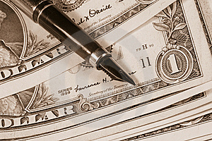 Pen On Dollar Bills Royalty Free Stock Photography - Image: 10302847