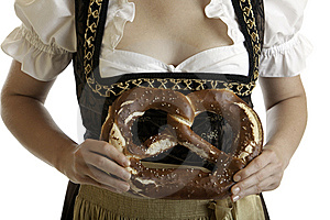 Bavarian Girl In Dirndl With Oktoberfest Pretzel Royalty Free Stock Photography - Image: 10306267