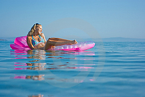 Blonde Girl On Inflatable Raft Royalty Free Stock Photography - Image: 10306727