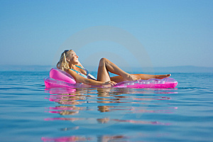 Blonde Girl On Inflatable Raft Royalty Free Stock Photos - Image: 10306728