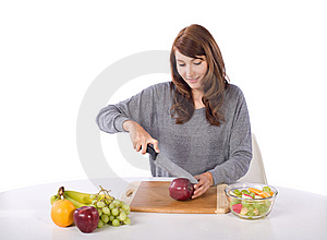 Woman Cutting An Apple Stock Images - Image: 10314654