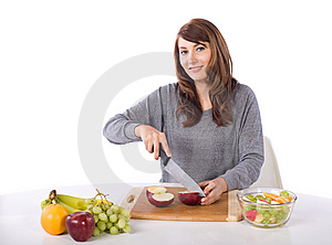 Woman Cutting An Apple Stock Photography - Image: 10314692