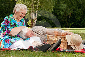 Grandmother is tickling grandfather Stock Photos