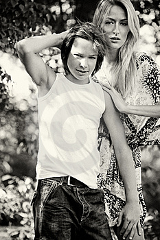 Sturdy Guy With A Beautifull Woman Royalty Free Stock Images - Image: 10326529