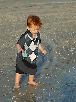 Little Boy On The Beach Alone Stock Images - Image: 10326964