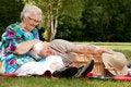 Grandmother is tickling grandfather Stock Photos