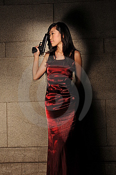 Woman Holding A Revolver In An Underground Tunnel Royalty Free Stock Photos - Image: 10336298