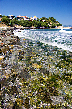 Stony Beach And Some Houses Royalty Free Stock Image - Image: 10337986