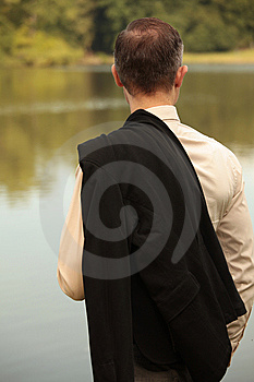 Man With Jacket At The Shore Stock Images - Image: 10338924