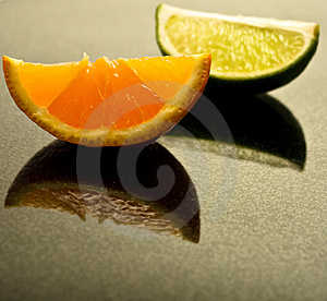 Lime And Tangerine Wedges On Polished Granite Royalty Free Stock Image - Image: 10343636