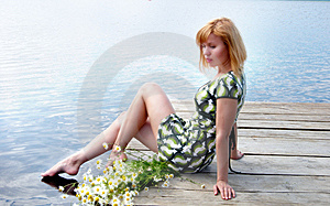 Woman With Daisies On The Pier Royalty Free Stock Image - Image: 10344076