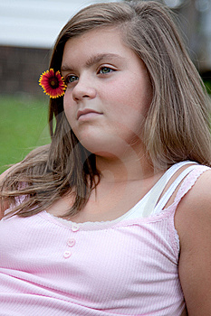 Young Girl Outdoors With Flower Stock Image - Image: 10348251