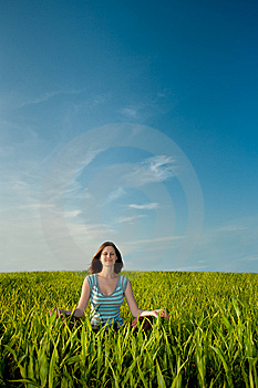 Woman on field Royalty Free Stock Image