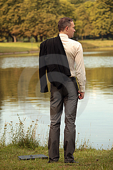 Man With Jacket At The Shore Royalty Free Stock Photography - Image: 10351027