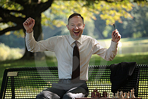 Happy Businessman Playing Chess Stock Photography - Image: 10351082