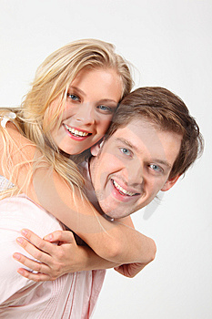 Girl Embraces Young Man For Neck Behind Royalty Free Stock Photo - Image: 10353865
