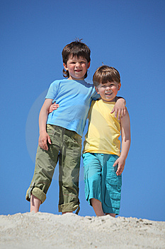 Two Boys Embrace Each Other On Sand Stock Photography - Image: 10354122