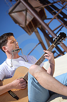 Guy Plays Guitar And  Lip Accordion Royalty Free Stock Images - Image: 10354419
