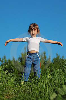 Girl Makes Gymnastic In Grass Royalty Free Stock Photo - Image: 10354725