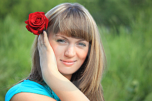 Girl With Red Rose In Hair Stock Photo - Image: 10355060
