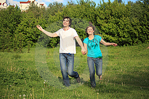 Smiling Pair Runs, Keeping For Hands, In Park Royalty Free Stock Image - Image: 10355236