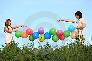 Girl And Guy Hold Garland Of Balloons Stock Photography - Image: 10355352