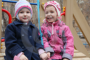 Two Smiling Girls On Playground Royalty Free Stock Image - Image: 10355436