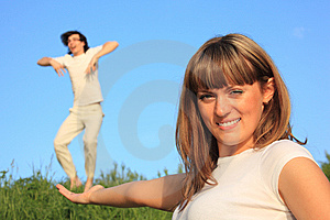 Girl Holds  Guy On  Palm Stock Photography - Image: 10355642