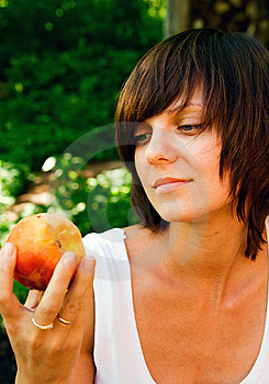 Woman And A Peach Stock Photography - Image: 10425122