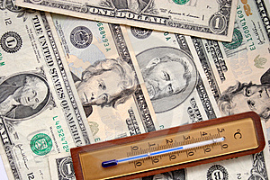 Dollars And Thermometer Stock Photo - Image: 1057670