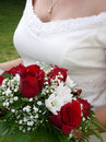 Wedding bouquet and bride's bust Stock Photos