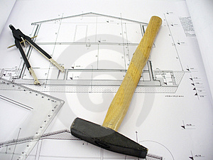 Hammer on house plans Royalty Free Stock Photo