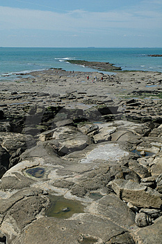 Walking On A Rocky Beach Royalty Free Stock Photography - Image: 1072937