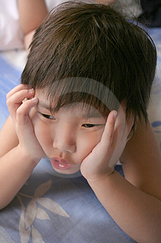 Day-dreaming Boy Stock Image - Image: 1075231