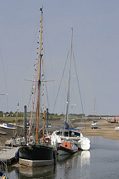 Tall Boats At Low Tide Stock Photos - Image: 1077913