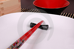 Chopsticks On White Plate Royalty Free Stock Photo - Image: 1128805