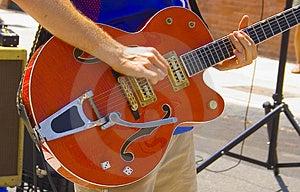 Man Playing Red Guitar Stock Photo - Image: 1130050